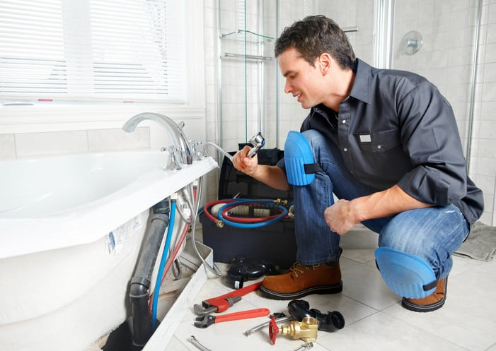 plumber using drain line cleaners