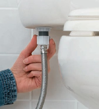 plumber connecting water supply to the toilet tank
