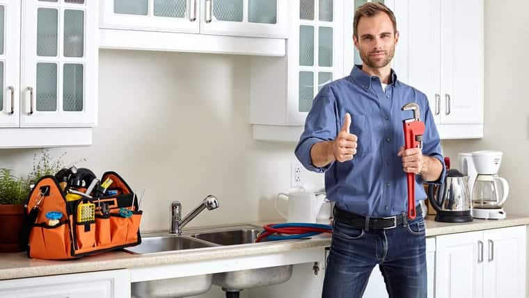 plumber servicing a house in alexandria nsw