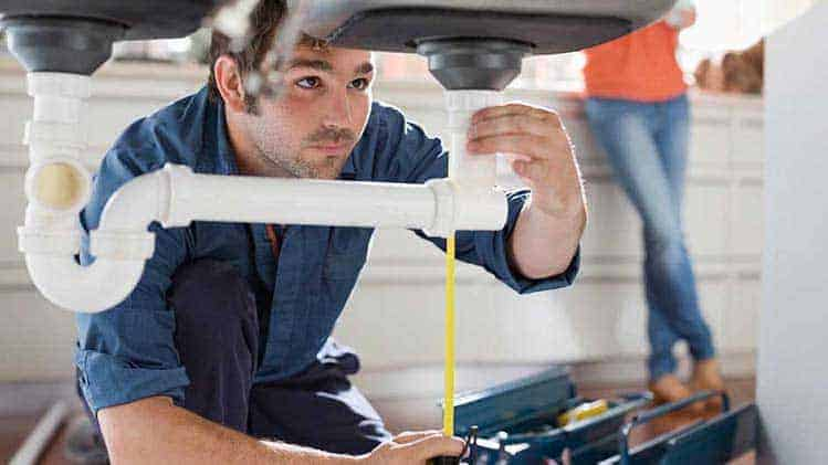 liverpool plumber checking home plumbing system