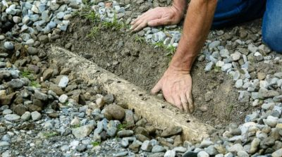 plumber unclogging a french drain